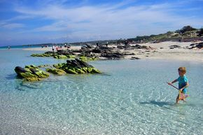 The shallow beach at La Pelosa is ideal for kids | Sardinia's best beaches, from sandy to pebbly to pink | Weather2Travel.com #italy #beach #travel