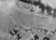 An aerial photograph of vessels burning in Darwin Harbour taken by a Japanese airman during the first raid.