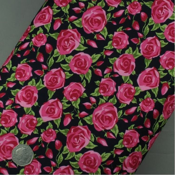 Bold cerise rose on black fabric 100% cotton fabric - sold per metre