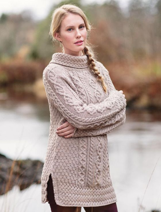The Aran Cowl Neck Tunic Sweater is stunning and sure to turn heads this season. Authentically crafted in Ireland using 100% merino soft wool. This long tunic cable knit sweater is now available to Order from the Aran Sweater Market