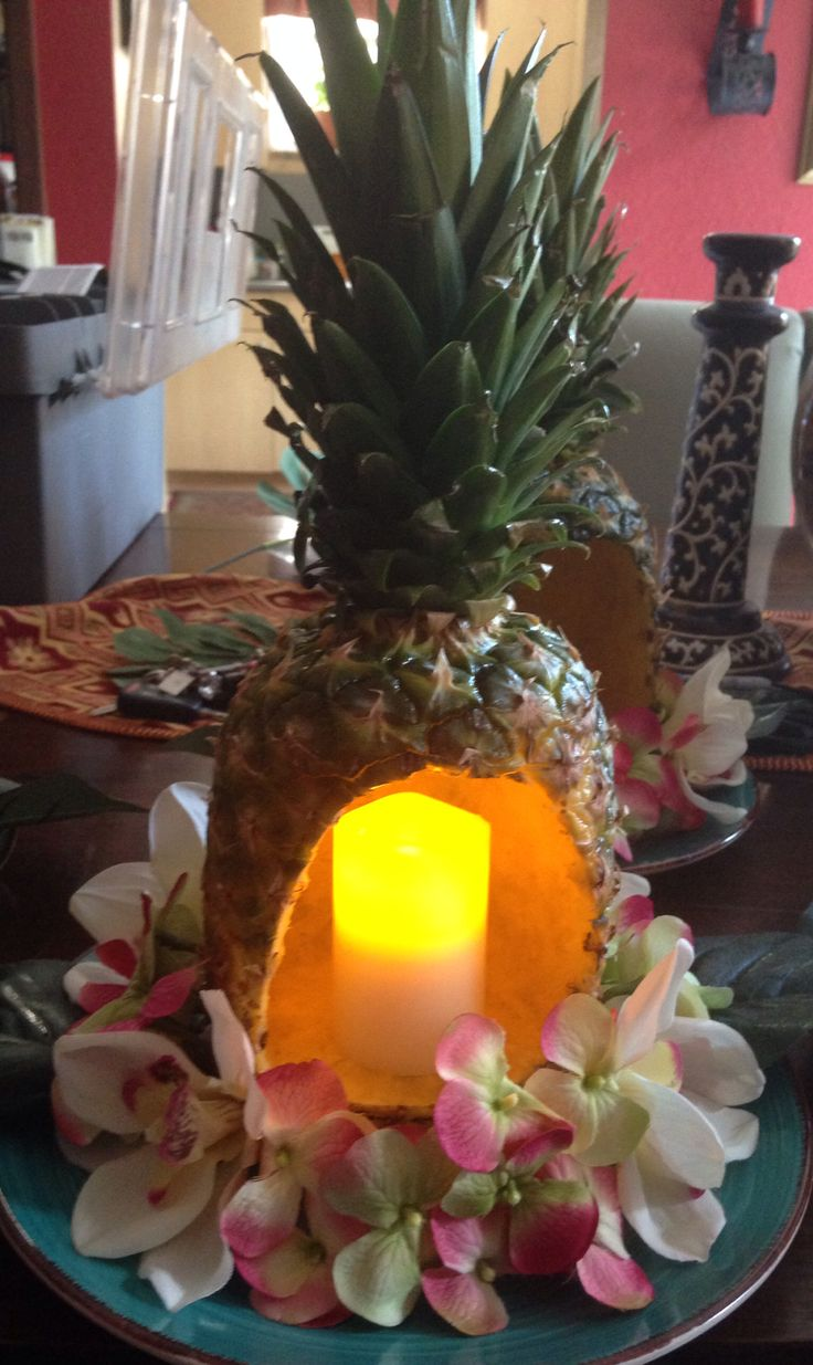 Pineapple centerpiece for luau themed party so proud of for Tropical themed house