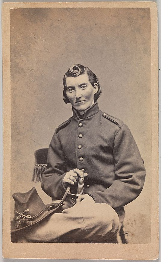 Frances Clayton —a woman who served in the Union army by disguising herself as a man. In a popular carte de visite collected by soldiers at the end of the war, she poses here as Jack Williams and suggestively holds the handle of a cavalry sword between her crossed legs. The facts of her life story and military service are difficult to confirm, but it is believed that she served in the Missouri cavalry (or infantry) beside her husband, who died at the Battle of Stones River in late December…