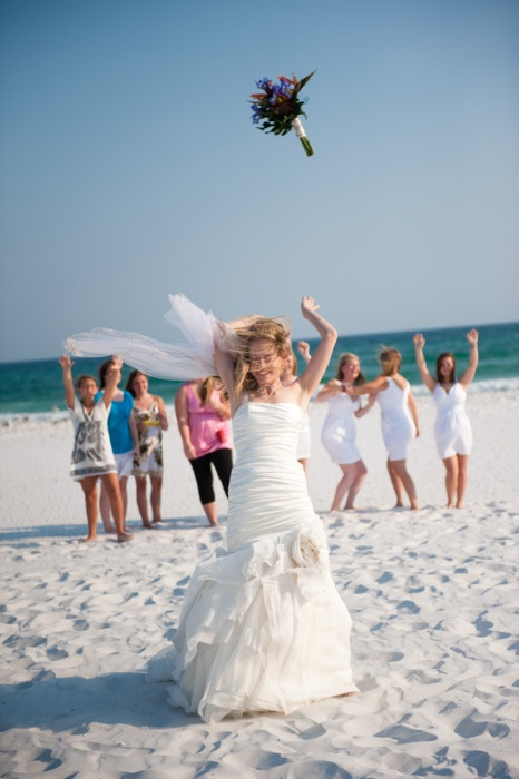 Bouquet toss on the beach.  Destin beach wedding.  http://paradisobeachweddings.com