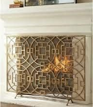 Asian Influenced Decor: This fireplace screen shows an Asian influence.