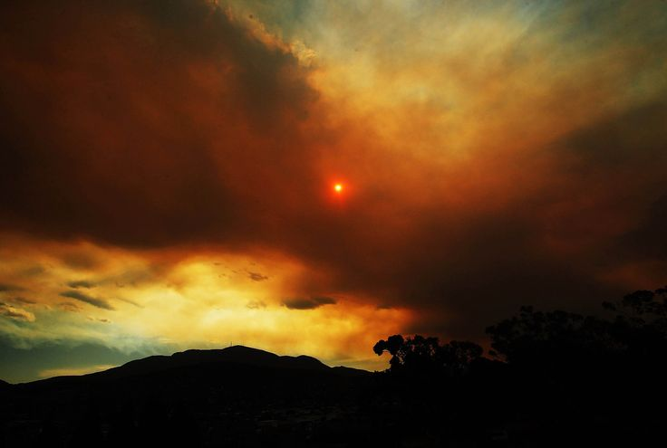 Stunning Images From Around The World. Clouds from a nearby bushfire are seen over Mount Wellington during day one of the Hobart International at Domain Tennis Centre on January 4, 2013 in Hobart, Australia. (Mark Metcalfe, Getty Images)