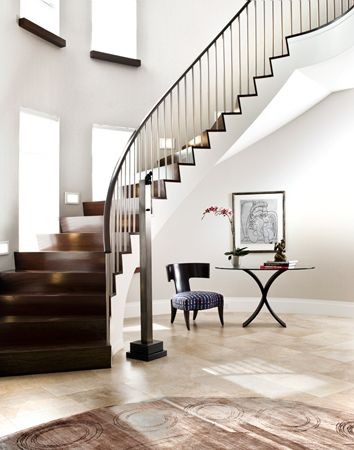 Love how the staircase doesn't come all the way down to form a wall that takes up perfectly good space. Instead this one leaves a very functional alcove.
