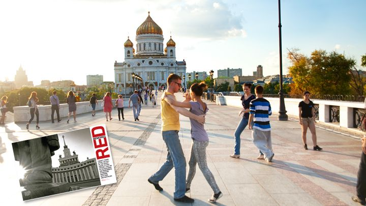 Impromptu dancers on the Patriarchal Bridge over the Moscow River with the grandiose Church of Christ the Saviour behind them. The architecture is old, the spirit renewed. Check out our MOSCOW feature this month