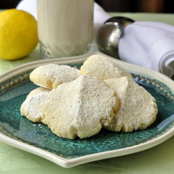 Lemon Snow Cookies - These soft, almost cake-like cookies make a very welcome afternoon treat with a steaming cup of tea or tall glass of cold milk. They can easily be prepared in a few minutes and if you like, you can keep the wrapped dough in the fridge for 2 or 3 days so that you can bake them off fresh a few at a time.