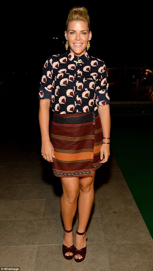 Fall look: Actress Busy Philipps mixed florals and stripes at a LOFT party to launch her c...