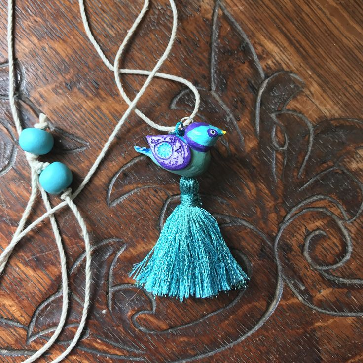 A personal favorite from my Etsy shop https://www.etsy.com/listing/537662482/bird-necklace-polymer-clay-tassel