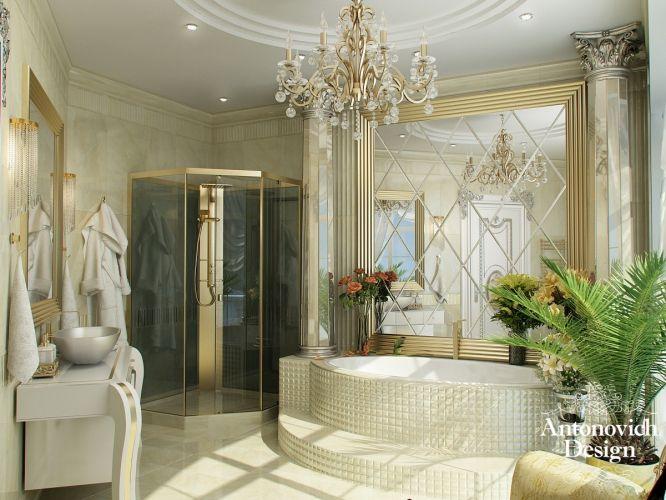 Ванная комната наполнена светом и роскошью.  Белый потолок с точечной подсветкой и золотистой изящной люстрой, светлый кафель на полу и на стенах, золотистые вкрапления декора, оригинальная ванна-джакузи - это всё для настоящей королевы.