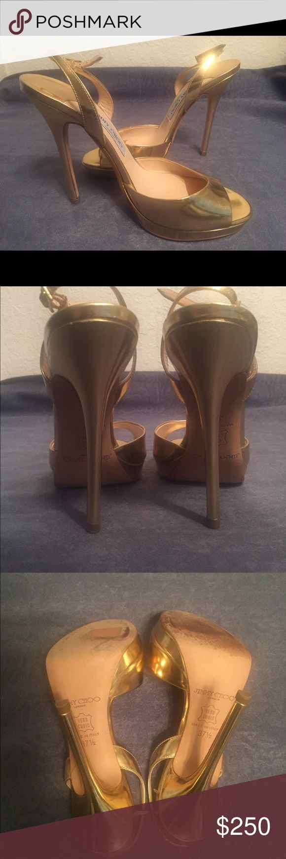 """Authentic Jimmy Choo gold open toe heel 37.5  Beautiful authentic Jimmy Choo gold open toe sandal heel.    • Preowned only worn twice • Size 37.5 • Heel height 4 3/4"""" • In overall very good condition, one black mark noted in photos.  Photos taken the day of listing. Jimmy Choo Shoes Heels"""