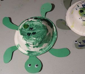 """Turtle Craft for letter """"T"""". Small paper bowl, green construction paper, green paint and googly eyes; add a dessert plate on the bottom for a belly"""