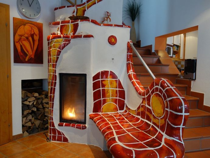 Beautiful masonry heater Looks a little spiddy inspired when painted this way.