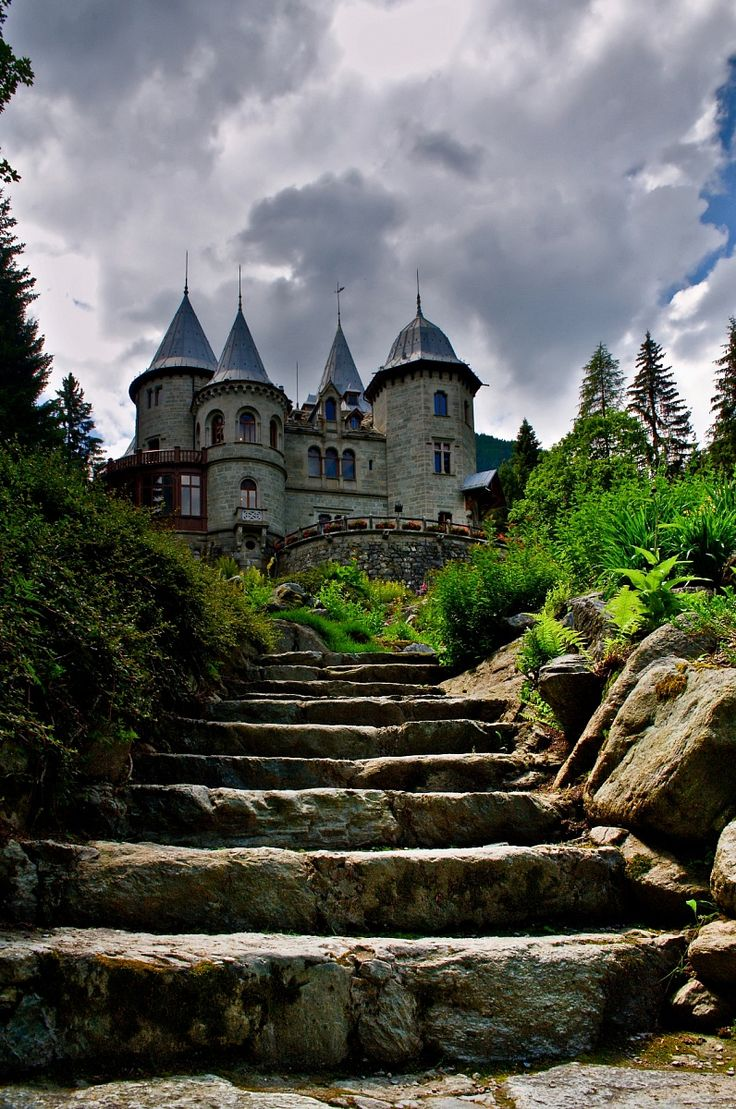"""Castello dei Savoia,  Gressoney Saint Jean, Valle d ' Aosta, Italy. Queen Margaret Castle stands at the foot of Ranzola hill, in the place known as """"Belvedere"""", as it dominates the whole of the valley. The building was erected between 1899 and 1904. Architect Emilio Stramucci designed the mediaeval-style castle, described as """"15th-century Lombard style"""", quite frequent in France and Savoy, the homelands of the reigning sovereigns."""