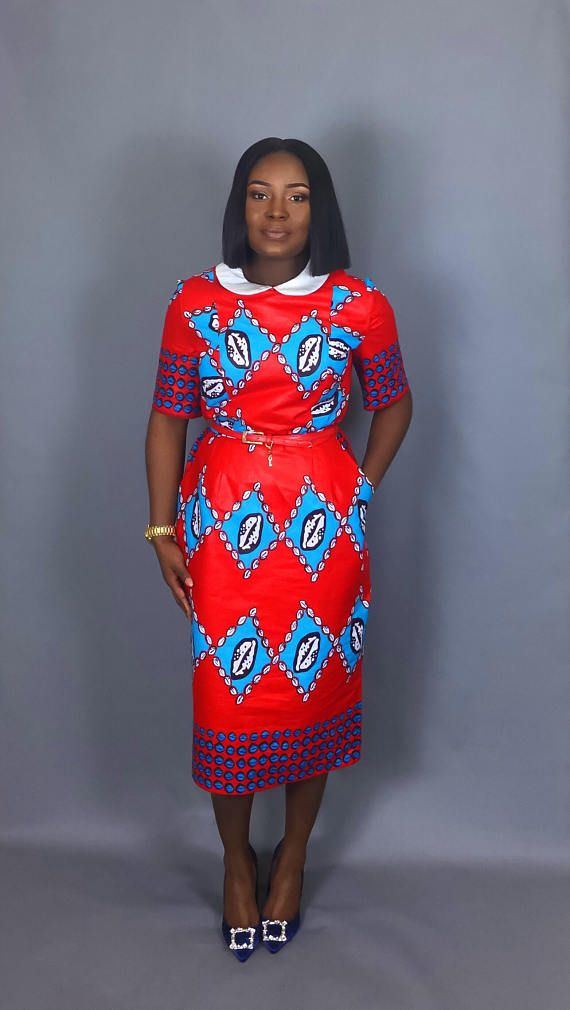 Multi colour mix print classic fitted dress .Very flattering slim fit Ankara African print dress for that elegant look Made from 100% authentic cotton wax print Fitted multi colour African wax print dress fits below the knee and perfect dress for that special occasion! Fully lined and
