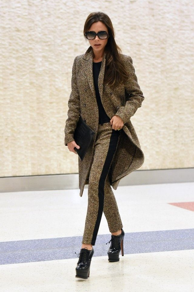 Victoria Beckham wearing  Azzedine Alaia Lace-up leather Ankle Boots, Cutler and Gross 0811 Sunglasses, Victoria Beckham FW16 Trousers