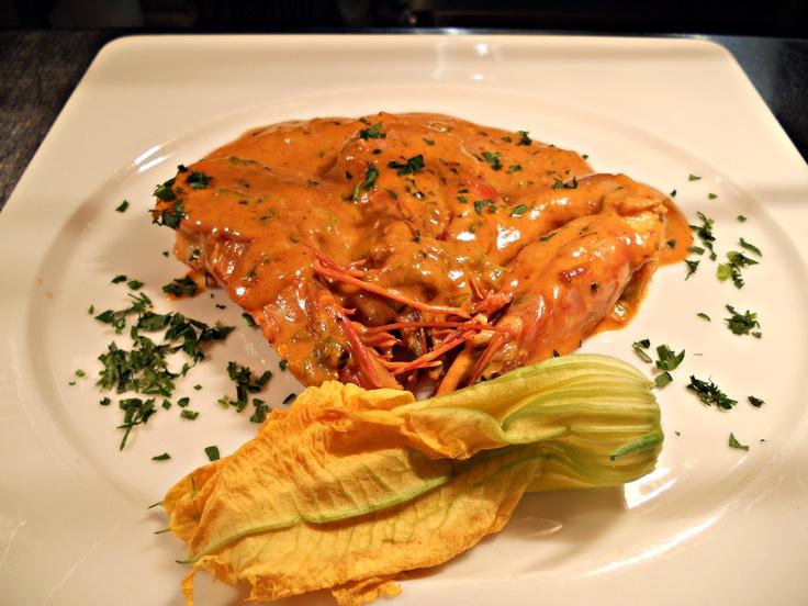 Tiger prawns with zucchini flowers, cream and fresh tomato sauce