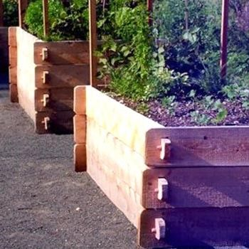 An elegant age-old design for raised garden beds. The Farmstead Raised Garden Beds are based on a 17th century, easy to assemble design. Hand crafted of Vermont White Cedar, these raised beds will last for many years and weather to a soft silver grey