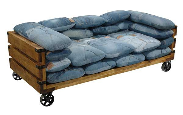 Pallet couch on wheels with denim pillows.: