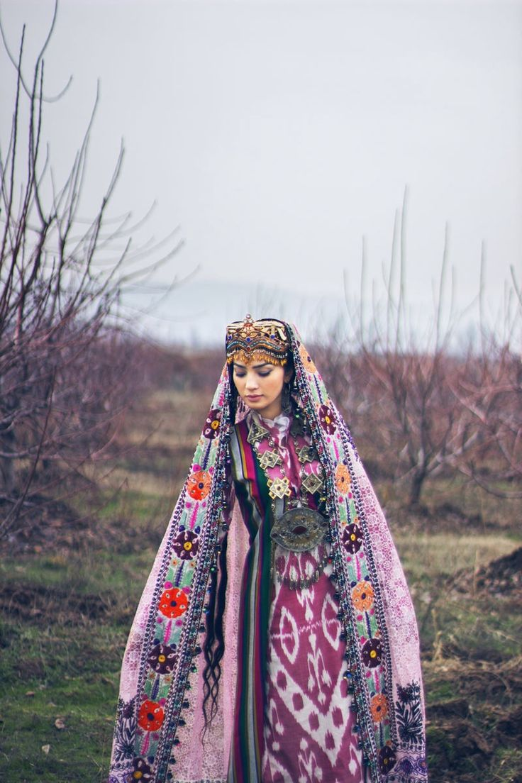 Central Asia | Portrait of a woman wearing traditional clothes, Tajikstan