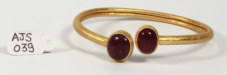Bangle in 925sterling silver with 18k gold micron plating with Ruby gemstone