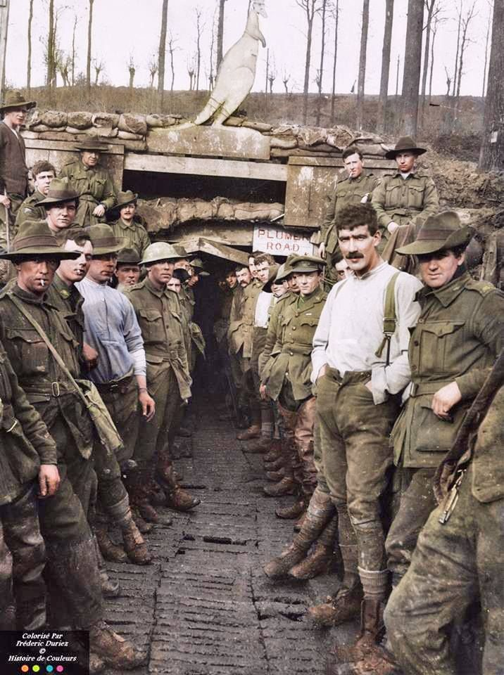 A group of Australian 7th Field Company Engineers at the 'Plumer Road' entrance to 'Wallangara', or the Catacombs as it was generally called, a system of tunnels built in Hill 63, Messines Ploegsteert Wood, 22nd January 1918. The soldier on the right in the white shirt has been identified as Driver - Alexander Henderson Priest (17822) from Collingwood, Victoria (demobbed in 1919 in good health) (Photo source - Official Photo no.E4487) Tasmanian Archives and Heritage Office: W.L. Crowther…