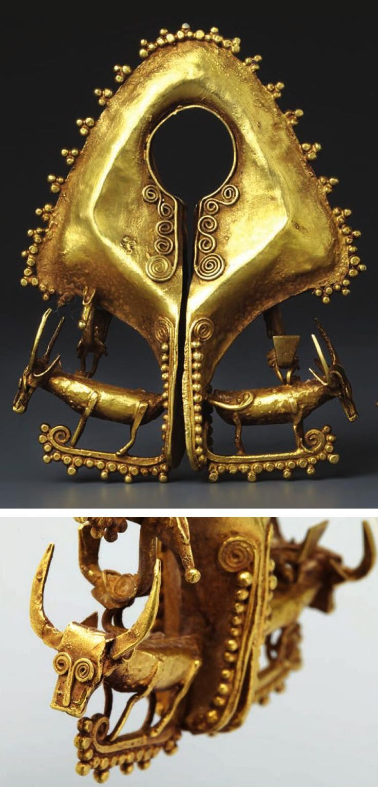 Indonesia ~ East Sumba | Pendant with water buffalo (mamuli); gold | 19th - 20th century || Source: 'Gold Jewellery of the Indonesian Archipelago', page 142