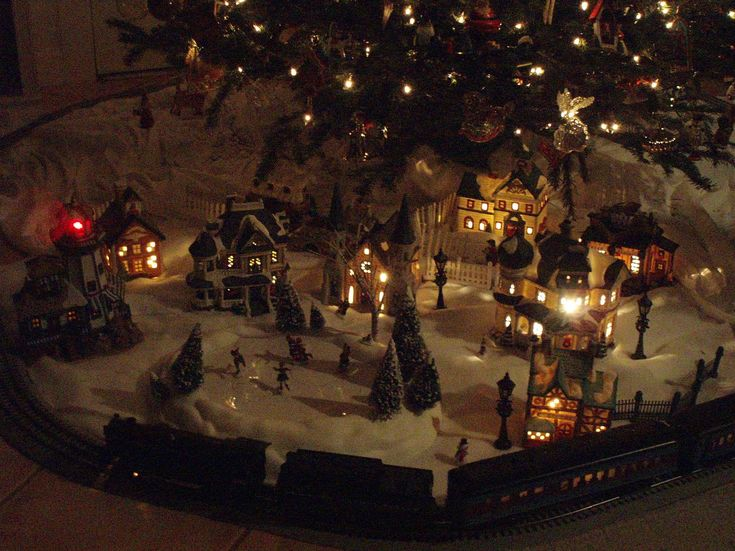 Last year we put my husband's train from when he was a kid under the tree. This year I'd like to make it into a christmas village under the tree for the train to go around: