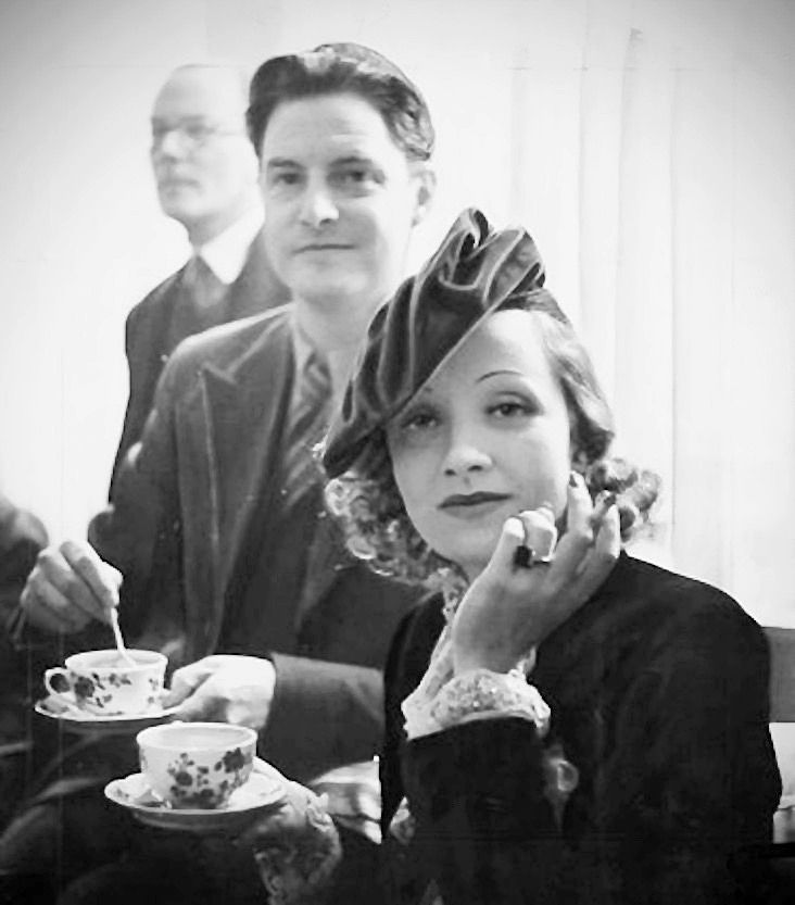 Marlene Dietrich and Robert Donat having tea at the start of filming Knight Without Armour in London, 1937