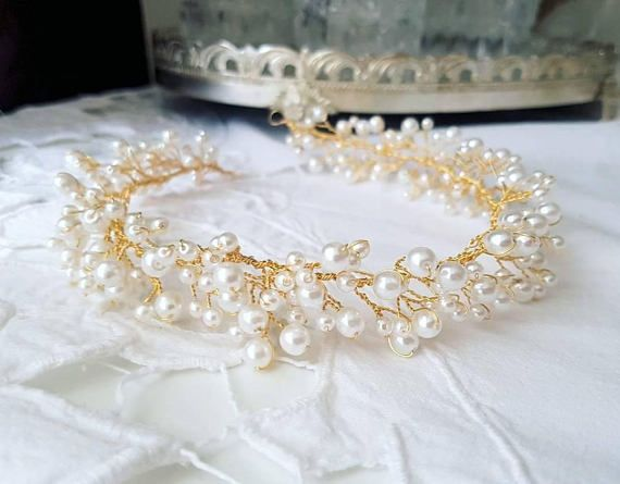 Check out this item in my Etsy shop https://www.etsy.com/listing/550491741/bridal-halo-pearl-wreath-golden-wedding