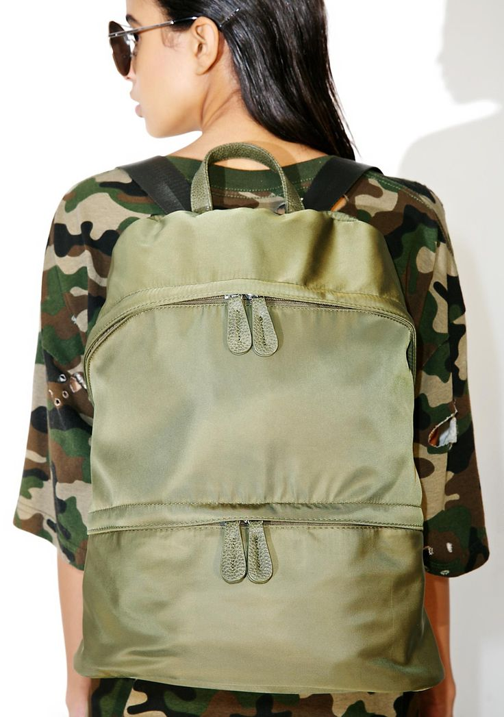 Go Time Backpack yer ready fer whatever comez yer way, babe. This olive green backpack features two zip pockets, adjustable black straps, and a roomy interior fer everything yew need.