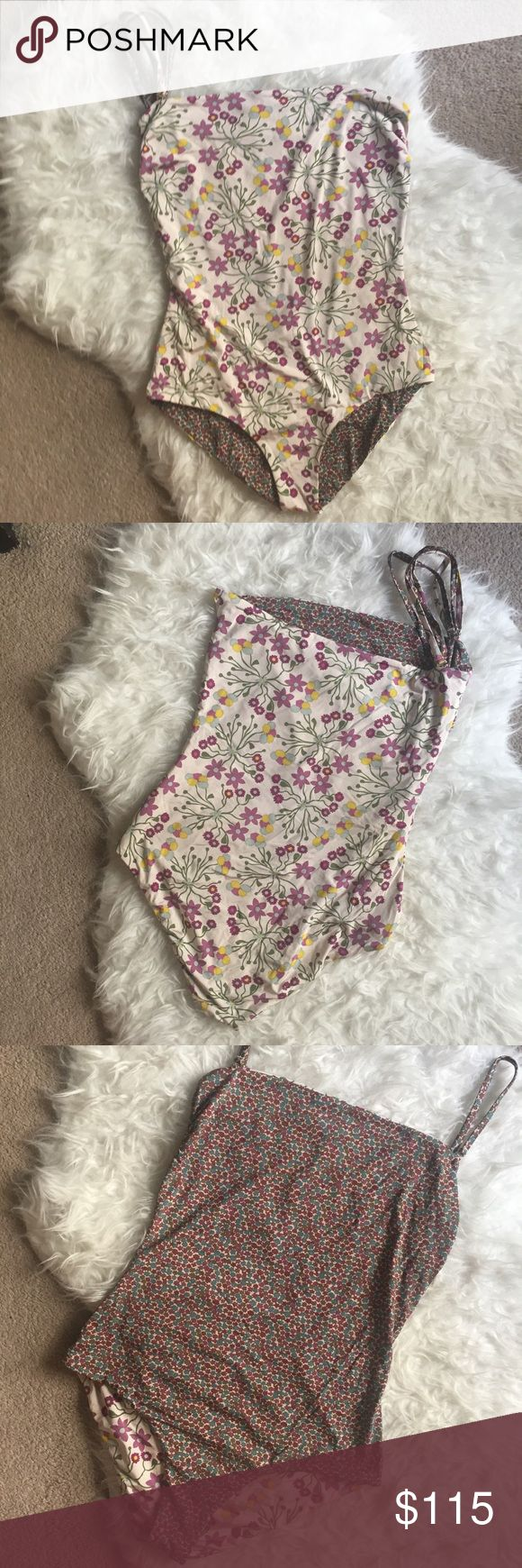 Anthropologie reversible floral one piece swimsuit Purple and tan floral reversible one piece. Has removable straps. Two in each pattern that can be adjusted and changed to many different styles. I think I only wore once, if that. Open to reasonable offers, but I probably won't go much lower. Says size 10, but it fit me and I normally wear a size small. Anthropologie Swim One Pieces