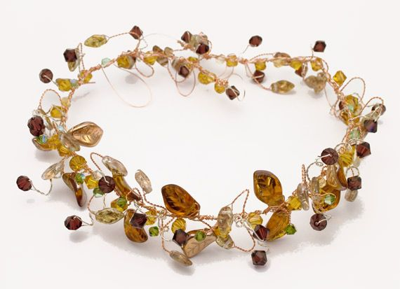 Medieval headband made on old gold enamelled wire. The glass leaves and crystals were in a rich brown green and burgundy colour scheme.