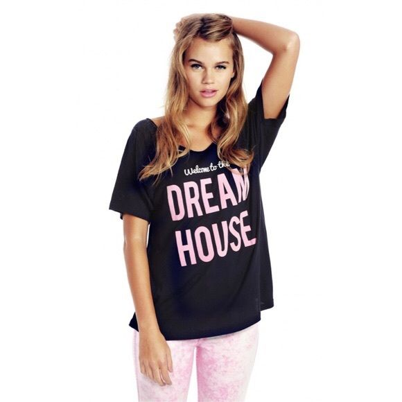 """COMING SOON NWT Wildfox Barbie Dream House Tee! COMING SOON, """"like"""" to be notified when it's in stock! Price will drop when it's available. Hard to find, sold out quickly! NWT Wildfox Barbie Dreamhouse T-Shirt! Size: Small. Color: Navy. Lightweight cotton jersey Scoop neckline Printed slogan design Low back Loose fit - falls loosely over body Machine wash 100% Cotton Wildfox Tops Tees - Short Sleeve"""