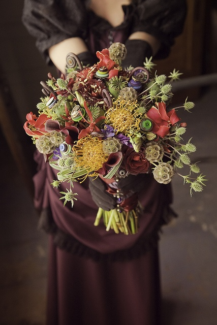 Steampunk bouquet of scabiosa pods, hocus pocus roses, thistle, protea, callas, fiddlehead fern curls, poppy pods, Gloriosa lilies, spider mokara, and lily grass...