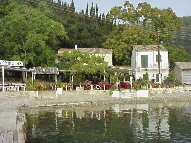 Taverna Nikolas with 'Olga's Cottage' to the right, Agni Bay, July 1999.