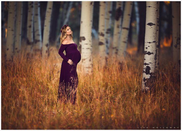 Beautiful pregnant woman has her portrait taken outside in an aspen grove in flagstaff, az