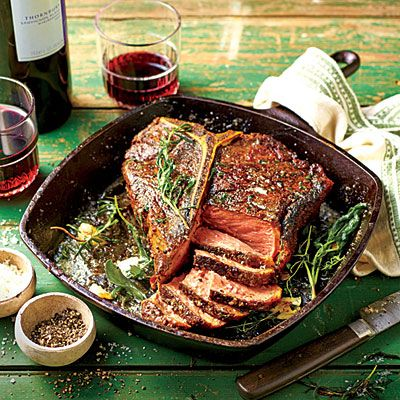 Cast-Iron Cowboy Steak | This is the best way to cook a thick, juicy bone-in steak restaurant-style without smoking up the house. Use your grill to heat the cast-iron skillet; the skillet surface area promotes a more assertive flavor and better sear than grill grates, yielding a steak with the proper steak house crust.