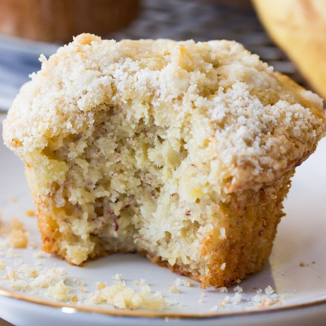 An incredibly soft, moist banana muffin recipe made with bakery-style high muffin tops, sweet banana flavor, and a simple (optional) streusel crumb topping! These arethevery best banana muffins I've ever made, and I think you're going to love them!