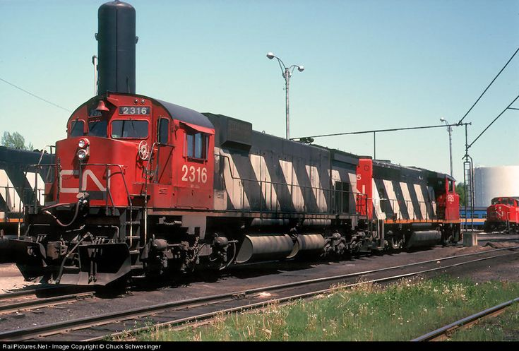CN 2316 is parked among the normal GP40-2W's at Capreol. The CN MLW's were not near as common in the Sudbury area as the CP's, but could be seen on occasion.