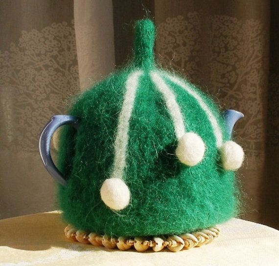 Teacosy knitted in Icelandic wool, felted to keep the tea really hot! suitable for approx. All my tea cosies have a name - this one is called Snowballs on gras (Snjóboltar á grasi) https://www.etsy.com/shop/Tehetta
