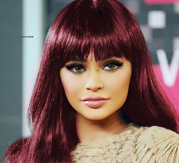 """Reality TV star Kylie Jenner showed off fiery red cornrows — a braided hairstyle — on her 19th birthday. The star, who officially celebrated her last year of being a teenager on Wednesday, treated her 70.4 million Instagram followers to an image of herself sporting some bright-coloured cornrows, and a lipstick kiss mark on her … Continue reading """"Kylie Jenner Flaunts Fiery Red Hair"""""""