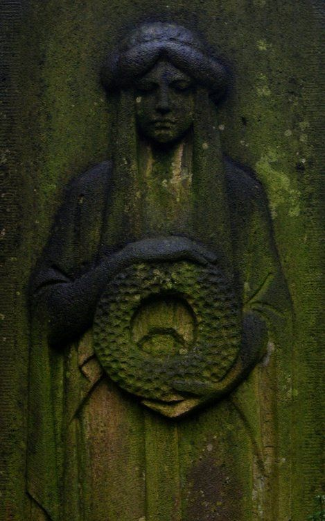 Goddess with wreath, taken at the Nordfriedhof (north cemetery) in Düsseldorf, Germany, on 6 December 2009.