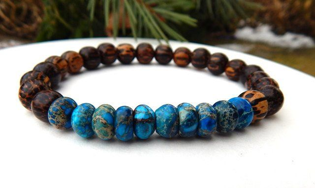 This very cool men's bracelet is made with Earthy Dark Blue Impression Jasper Rondelles and 9mm Old Palm Wood. Earthy and strong. Impression Jasper Properties: Soothes the mind bringing about clarity