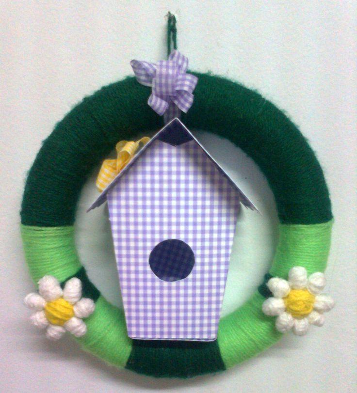 Wreath with a bird house