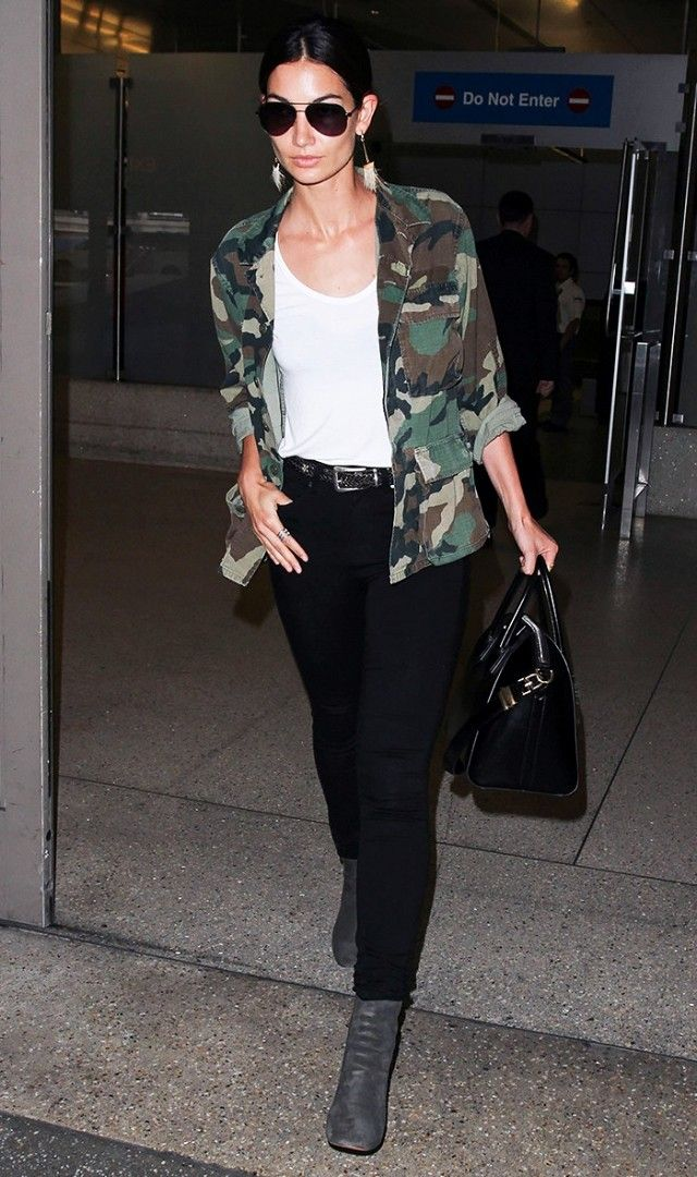 Lily Aldridge pulls off the ultimate model-off-duty look in a camo jacket.