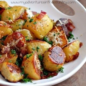 Oven roasted potatoes with olive oil, bacon, garlic, & parmesan cheese. Yum!