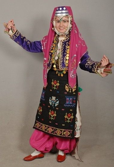 Traditional bridal/festive costume from the Izmir province.  Clothing style: rural, 1925-1950.  Ethnic group: Türkmen.  This is a recent workshop-made copy, as worn by folk dance groups.