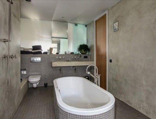 Stoere grijze badkamer met betonstuc